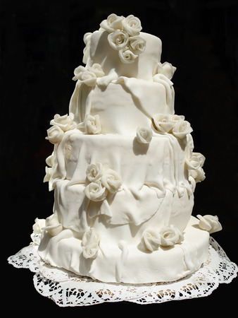 White iced wedding cake isolated on black background Stock Photo - 1565183