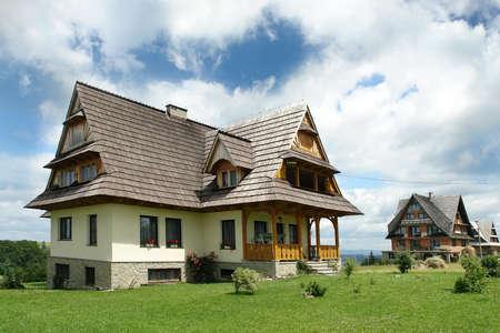Stylish highland cottage with wooden roof Stock Photo - 1615061