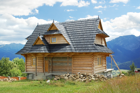 Stylish wooden highland cottage with view to Tatra mountains Stock Photo - 1615078