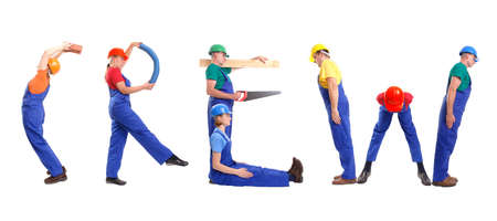 Group of young people wearing different color uniforms and hard hats forming Crew word - isolated on white background photo
