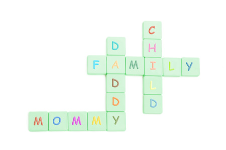 Colorful letter pieces to form crosswords of mommy, daddy,  and child over white background Stock Photo - 1665250