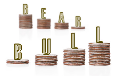 Bull vs. bear graph bars formed of two rows of american quarter coin piles over white background photo