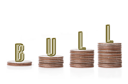 Bull graph bar formed of a row of american quarter coin piles over white background photo