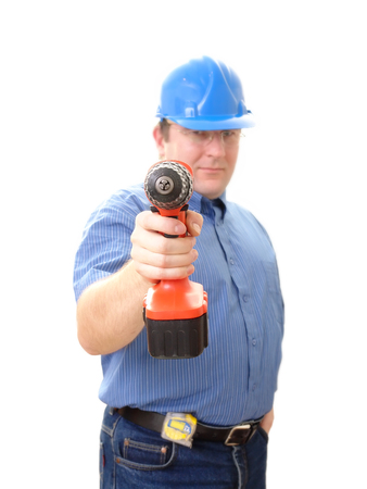 driller: Civil engineer wearing blue helmet with drilling maching over white - selective focus