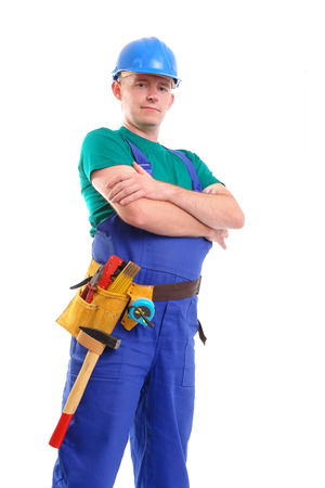 toolbelt: Builder wearing blue jumpsuit, helmet and toolbelt posing over white background