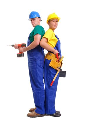 serviceman: Serviceman and servicewoman wearing yellow and blue helmet and blue overall standing back to back - man holding driller, woman holding black toolbox - isolated on white background