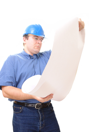 erection: Civil engineer wearing blue helmet studying a building plan over white Stock Photo