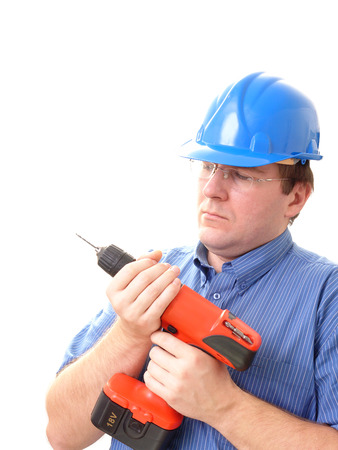 driller: Civil engineer wearing blue helmet changing drill bit in cordless borer over white