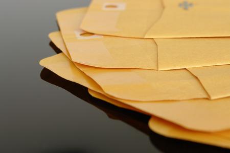 array: Array of yellow empty envelopes over black background