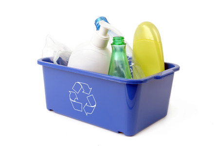 segregation: Blue plastic disposal bin with white recycle symbol containing plastic garbage - over white background