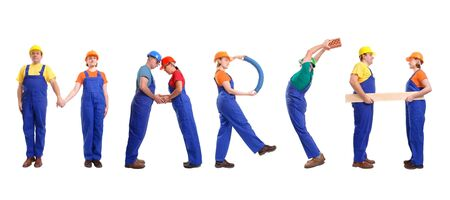Group of young people wearing different color uniforms and hard hats forming March word - isolated on white background - calendar concept photo