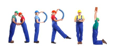 Group of young people wearing different color uniforms and hard hats forming April word - isolated on white background - calendar concept Stock Photo - 1738100