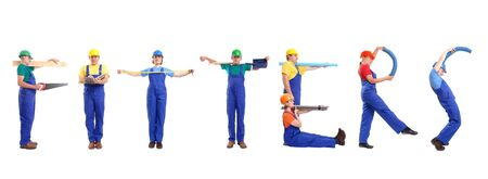 Group of young people wearing different color uniforms and hard hats forming Fitters word - isolated on white background photo