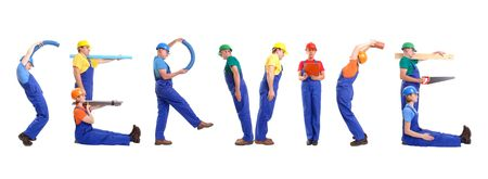 Group of young people wearing different color uniforms and hard hats forming Service word - isolated on white background