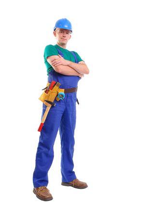 overall: Creador de uso de color azul, en general, y toolbelt casco posando sobre fondo blanco Foto de archivo