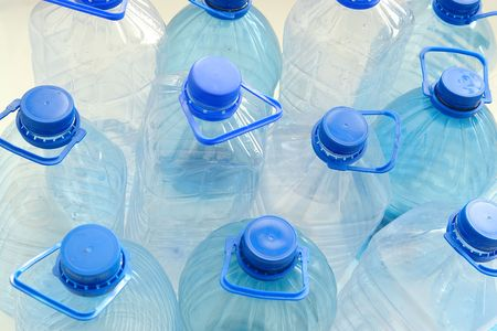 Closeup of empty plastic drinking water bottles photo