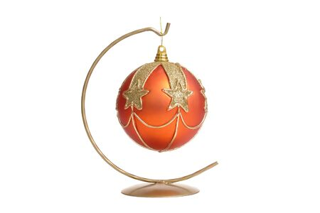 Orange christmas ball with star ornaments hanging on metal stand over white background Stock Photo - 1827450