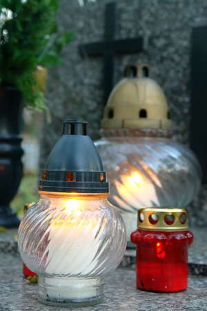 Votive candles lit on tombstone Stock Photo - 1978807