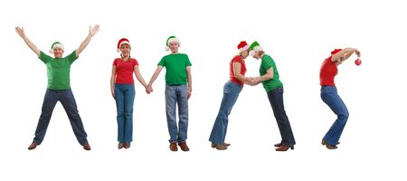Group of young people wearing green and red t-shirts and santa hats forming Xmas word over white background photo