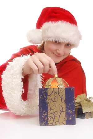 Santarina costume taking christmas ball out of box over white background Stock Photo - 2065914
