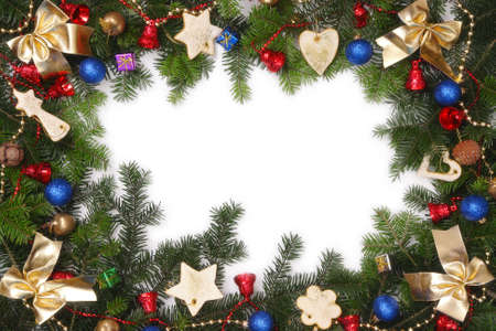 Christmas framework made of fir branches and various decorations with white copy space Stock Photo - 2087624