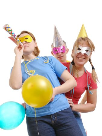 Group of friends wearing party masks and hats posing over white Stock Photo