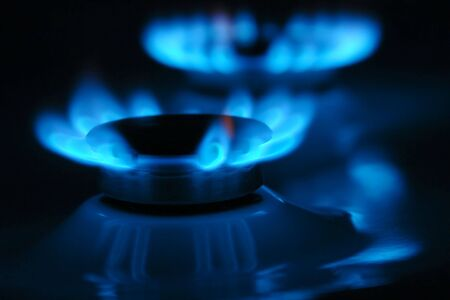 Two gas cooker burners lit in the dark photo