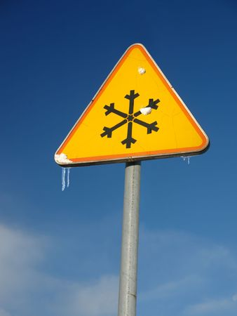 low temperature: Ice warning roadsign over blue sky