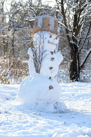 Snowman with cardboard box on top as hat Stock Photo - 2173872