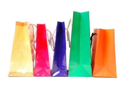 Line of five colorful paper shopping bags over white background photo