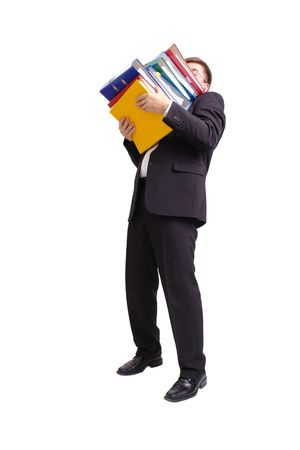 tedious: Businessman in black suit with pile of ring binders over white background Stock Photo