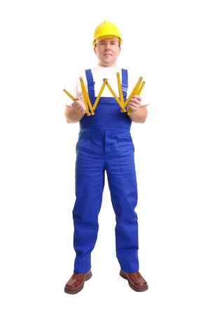 unfold: Builder wearing blue jumpsuit and yellow helmet unfolding wooden ruler over white background