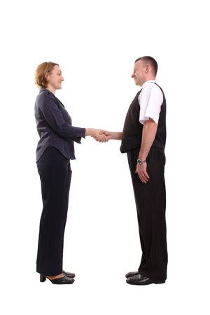 Businesswoman and businessman doing handshake over white background photo
