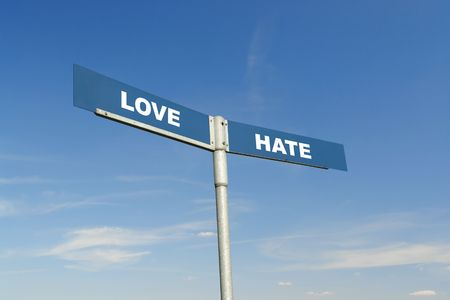 Blue metal two-way signpost with Love and Hate words over blue sky Stock Photo