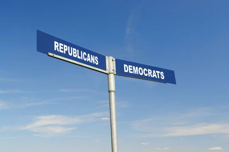 preference: Two-way metal signpost indicating Republicans and Democrats parties over blue sky Stock Photo
