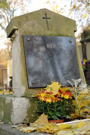 Closeup of tombstone with RIP black marble plate photo