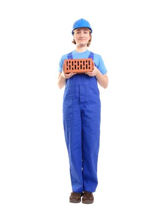 Female construction worker wearing blue jumpsuit and helmet holding brick over white background Stock Photo - 2521794