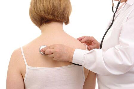 examining:  doctor examining female patient using stethoscope