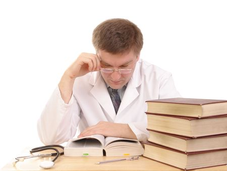 Young male doctor studying medical books - shot over white background Stock Photo - 2562717