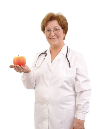 Senior female doctor with apple placed on her palm isolated on white background photo