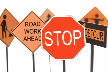 Closeup of stop sign with various american road construction signs in the background photo