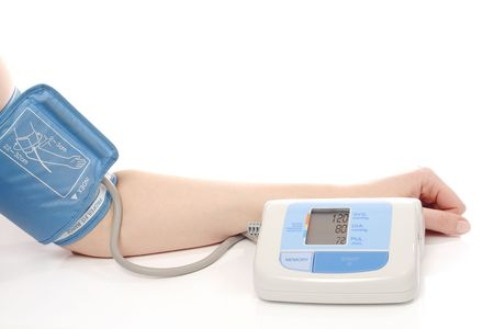 parameter: Digital blood pressure monitor put on female hand showing normal blood pressure parameters - shot over white background Stock Photo