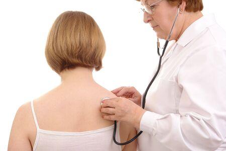 doctor examining female patient using stethoscope