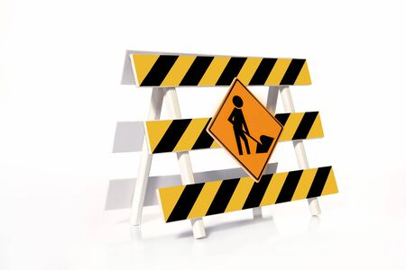 Yellow and black striped road construction barrier with Worker roadsign over white background Stock Photo - 2698973