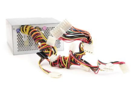 Computer power supply with plugs over white background photo
