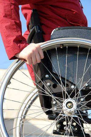 disable: Closeup of handicapped woman on wheelchair Stock Photo
