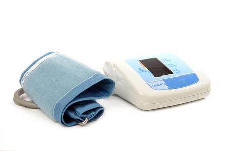 Digital blood pressure monitor over white background photo