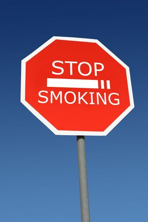 restricted: Stop smoking signpost over blue sky Stock Photo