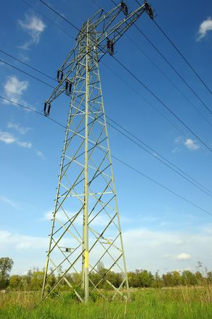 over voltage: High voltage pylon at countryside over blue sky