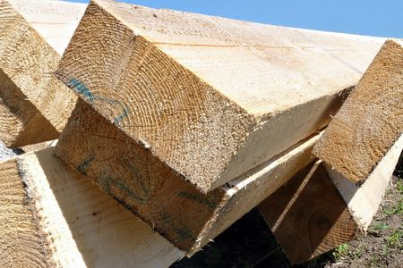 rafter: Timber for house rafter framing stacked on construction site
